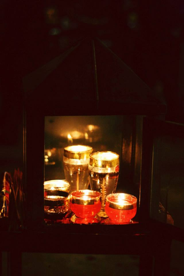 The cups of candle were protect by a small glass box. It is for prayer